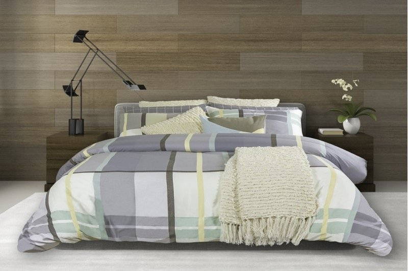 Grey white and yellow plaid duvet cover and pillow cases on king size bed
