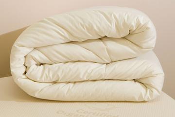 Folded white organic wool duvet