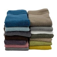 Stack of different coloured bamboo towels